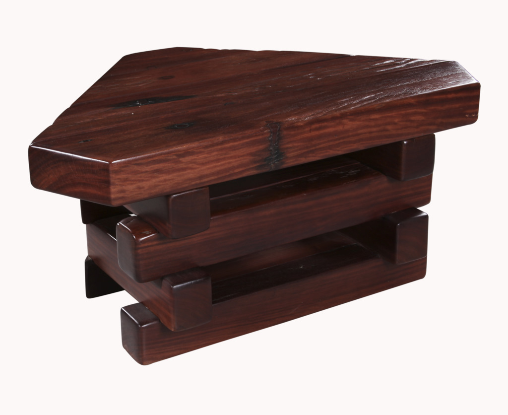Attractive corner unit made for a TV.  With deep grooves running through the timber which is a natural feature