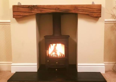 Arch mantle beam in sleeper with oil finish