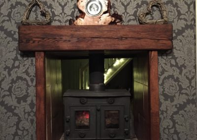 Dark oak fire surround with oil finish